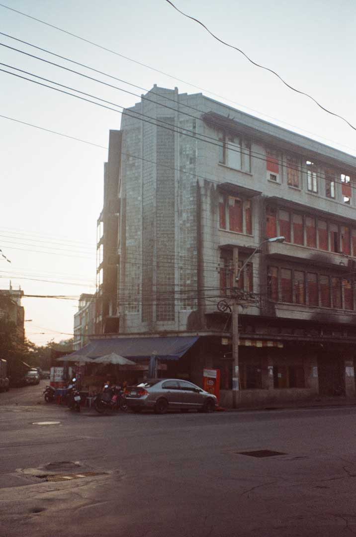 A building in Bangkok's China Town District taken on 35mm film. Better classified as a cityscape, architecture, urban exploration, or new topographics photography.