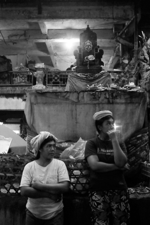 porters waiting for work just before dawn — pasar ubud