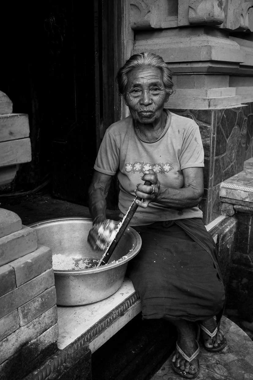 Balinese Woman Grating Coconut (Nyuh) near Ubud Bali - Bali Street Photographer Tours
