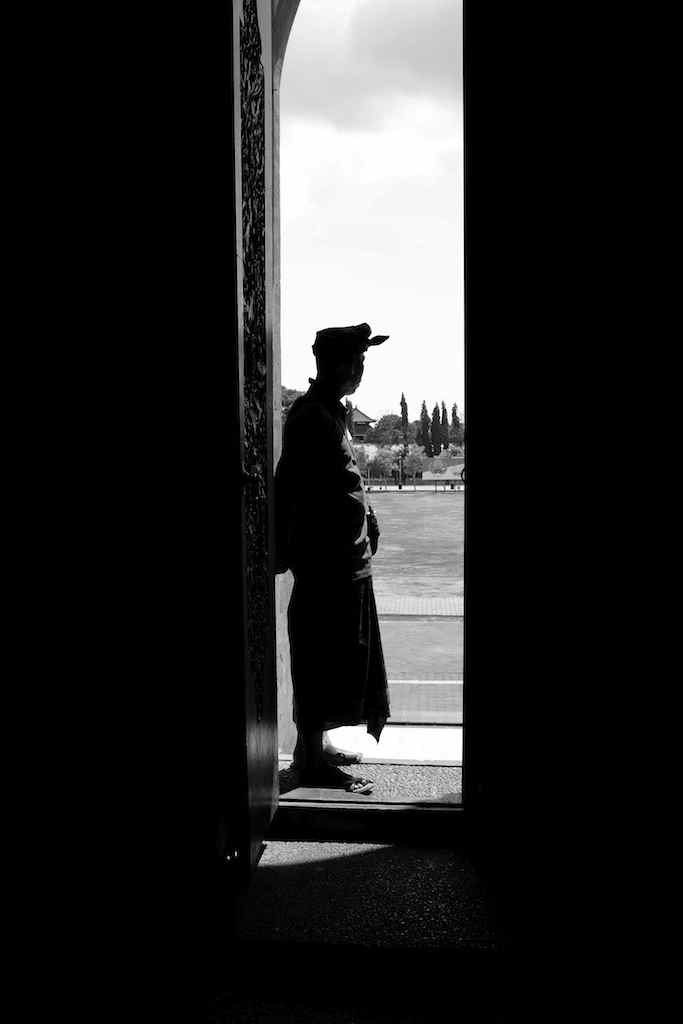 Silhouette of a Balinese Man is a Doorway - Bali Street Photographer