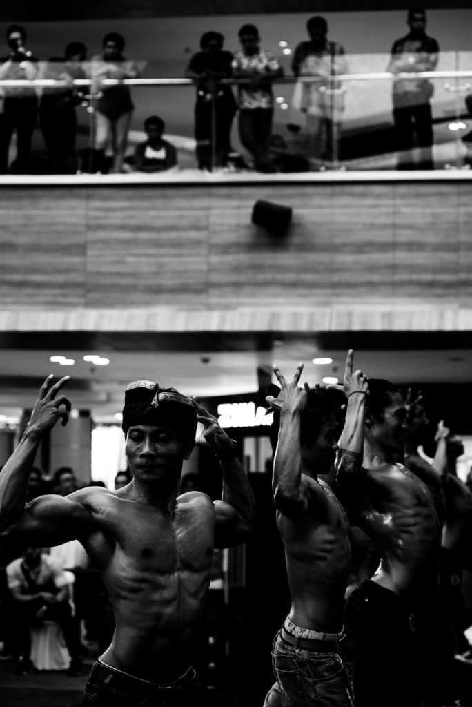 Finding creative ways to photograph a body building competition in Kuta Bali by Bali Street Photographer