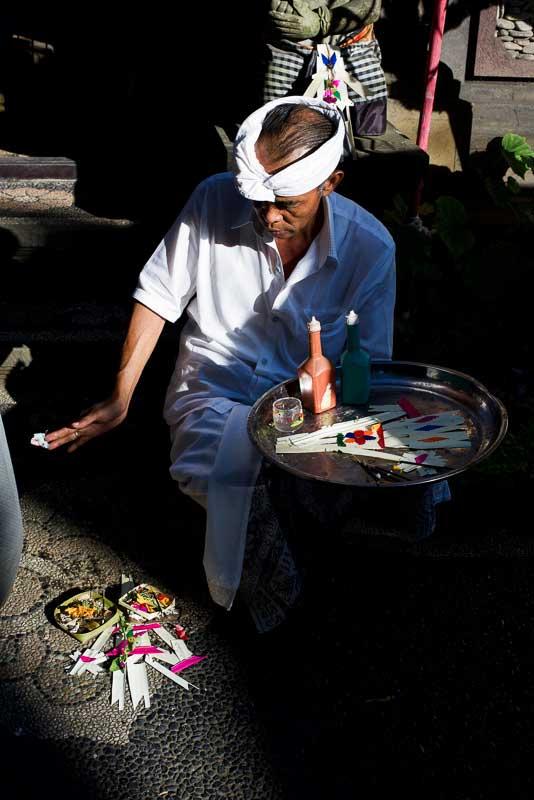 Balinese Man Making Offerings on Kuningan Day - Bali Street Photographer