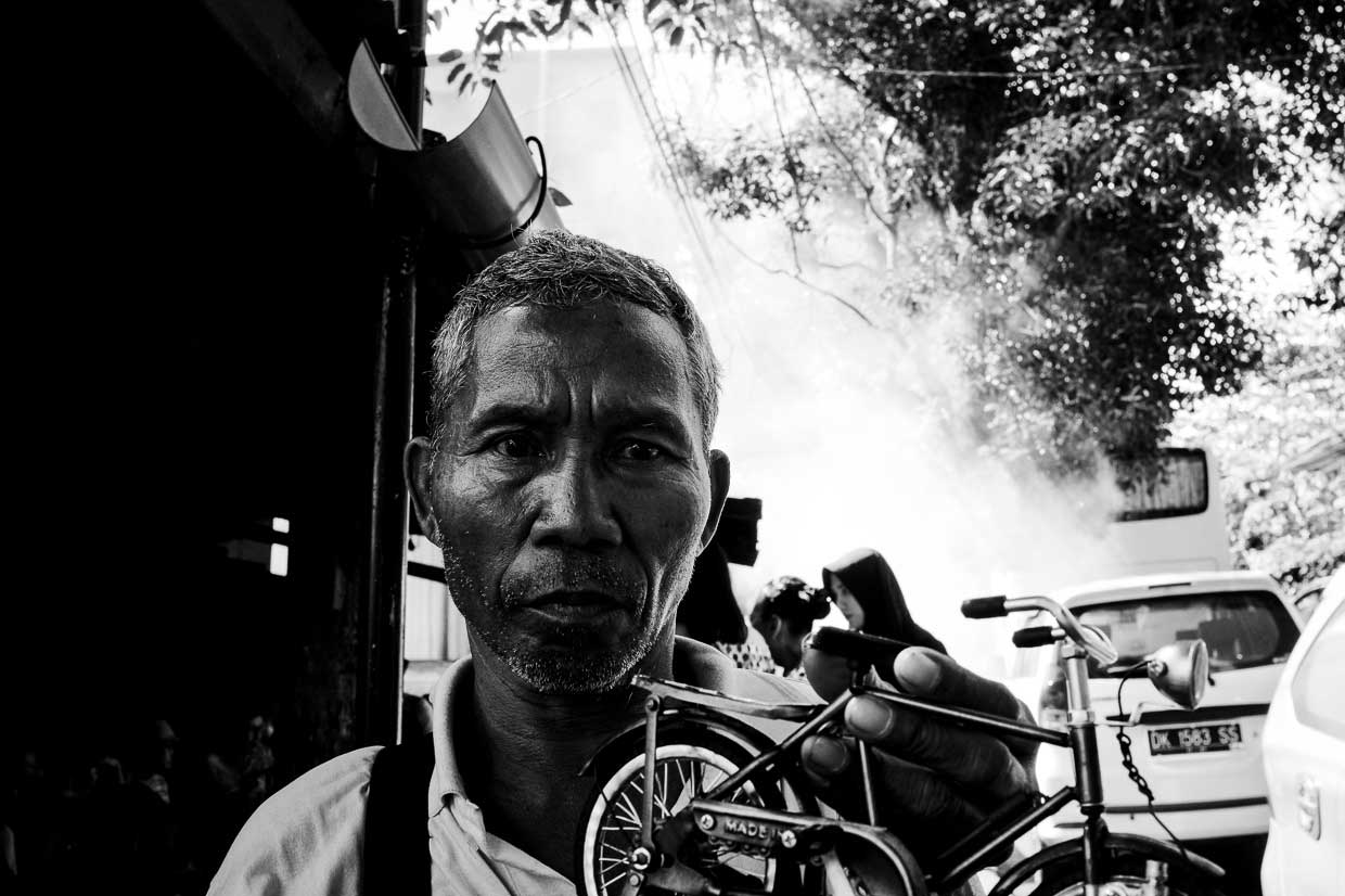 Toy Bicycle Vendor Outside Naughty Nuri's - Bali Street Photographer