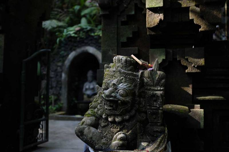 This is Bali - Canang Sari on a Statue - Bali Street Photographer