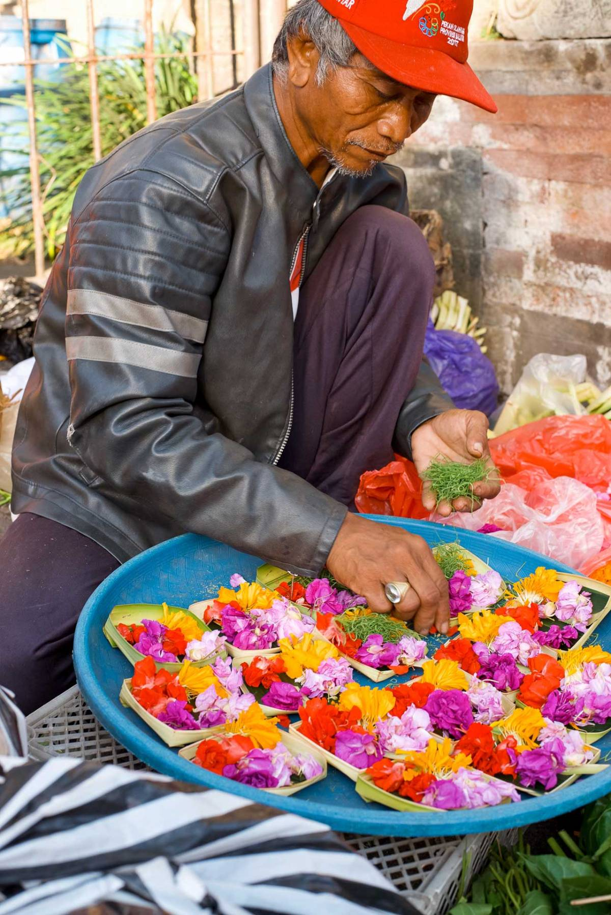 Balinese Man Making Canang Sari Offerings Pasar Ubud - Bali Street Photographer Tour